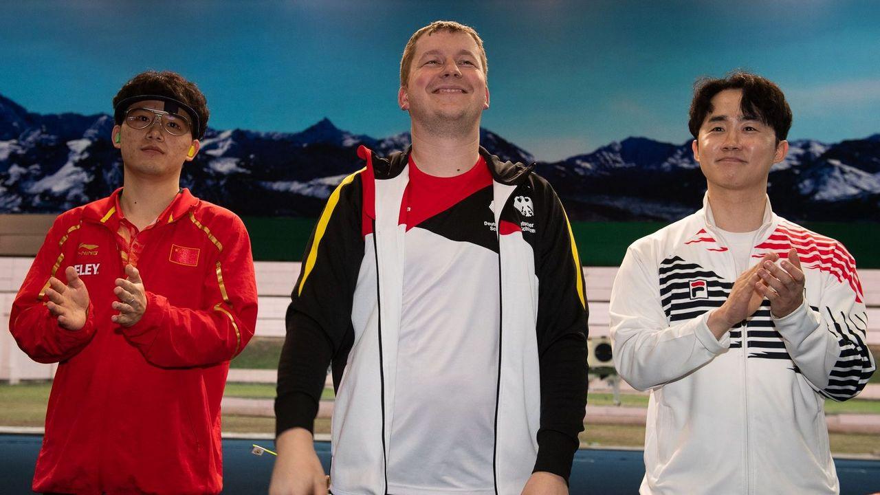 Foto: ISSF / Weltmeister Junmin Lin, Olympiasieger Christian Reitz und der Weltranglisten-4. Junhong Kim sind allesamt in München am Start.